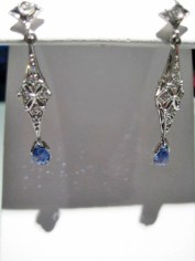 Platinum Earrings with .21c Diamond and Sapphire Artist: Varna Catalog: 105-6-8