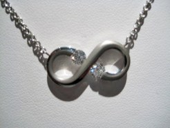 Platinum Necklace with .28c Diamond (chain included) Artist: Steve Kretchmer Catalog: 902-58-0