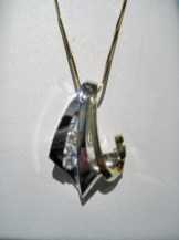 18K Y&W Gold Pendant and Chain with .20c Diamond Artist: Frank Catalog: 800-08-4 #19307 Price: $2,500.00 REDUCED: $795.00