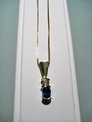 14K Gold Pendant and Chain with .50c Sapphire and .05c Diamond Artist: Frank Catalog: 800-17-8