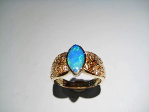 14K Gold Ring with Opal and .09c Diamond Artist: Kabana Stavros Catalog: 895-09-0
