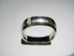 18K White Gold Ring with .07c Diamond Artist: Jean Francois Albert Catalog: 800-59-2