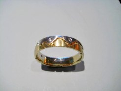 Platinum and 18K Gold Band with .07c Diamond Artist: Mark Michaels Catalog: 603-12-4