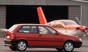 Red Fiat Tipo 16v and aircraft