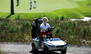 Lady driving the Volvo golf cart