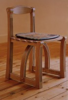 The Dove Chair in oiled oak with steam bent components and copper rivets. With Neil Bottle cushion.