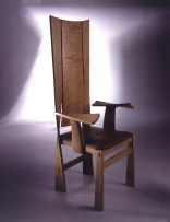 Highback Twist Carver in steam bent oiled oak with sewn padded Russia leather seat.