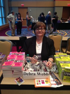 Deb Webb getting set up for RWA Literacy Booksigning