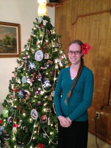 My daughter, Bethany, posing by our tree.