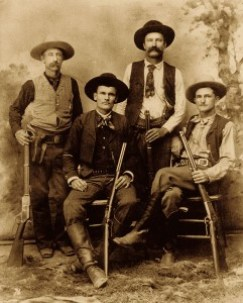 Four Texas Rangers - Jim Putnam is standing, third from the left.