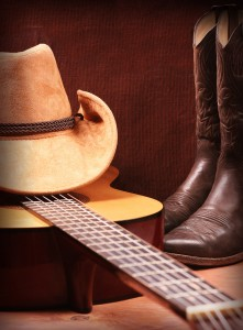 Country music with guitar and cowboy clothes