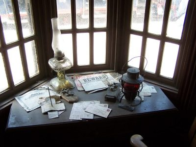 wanted posters on desk