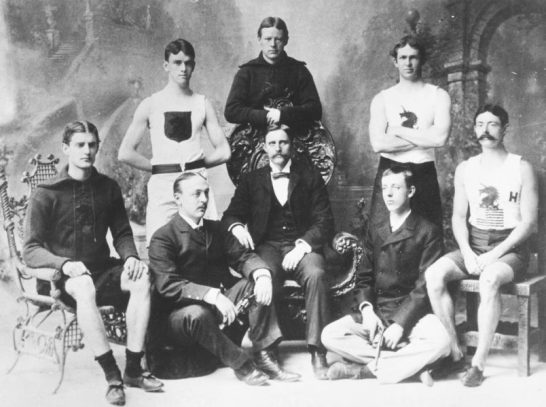 Sumner is seated on the floor second from the left and John is sitting on the floor second from the right.
