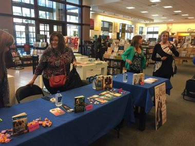 Jill is in the green sweater, my spot is to the left next to another fun author, J.D. Tyler who writes contemporary romance and paranormal romance.