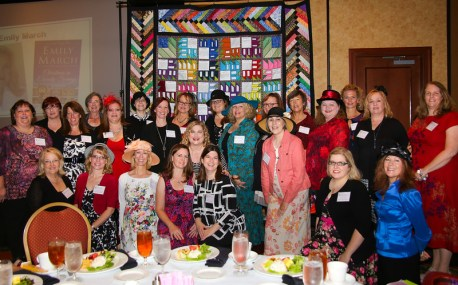 Participating authors with the signed quilt in the background.