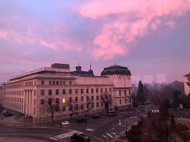 Before sunrise. Purple sky & a single lit window in the museum across the street. First Monday back to work for 2018. #Bulgaria #Sofia #sunrise #morningcolors #home