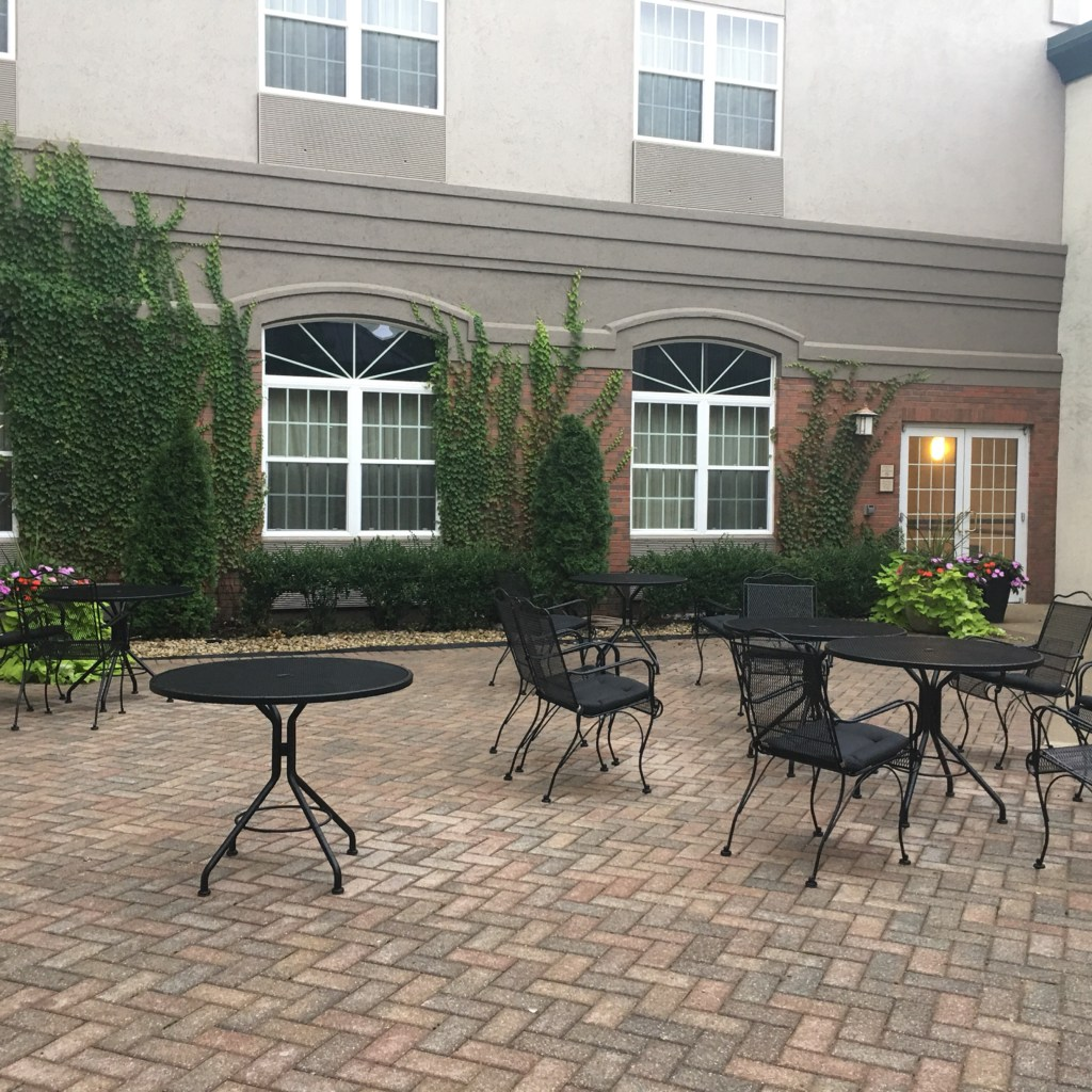 Picture of courtyard with paverstones and iron patio furniture