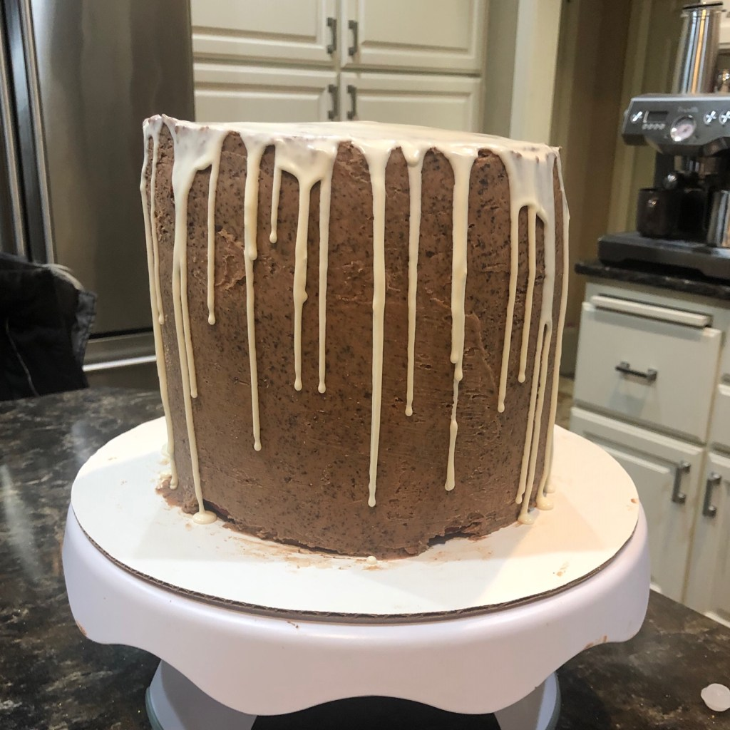 white chocolate ganache drizzle on a hot cocoa cake