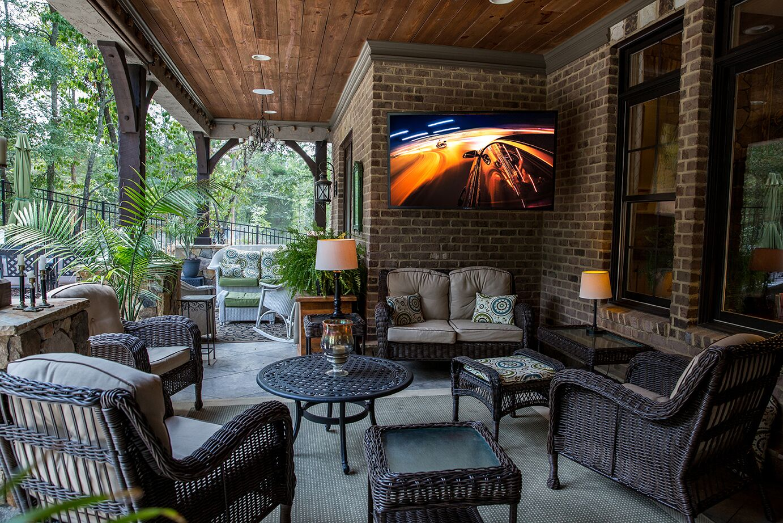 SunBriteTV on a brick porch