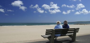 Senior couple relaxing at the seaside