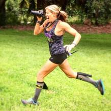 girl running with camera