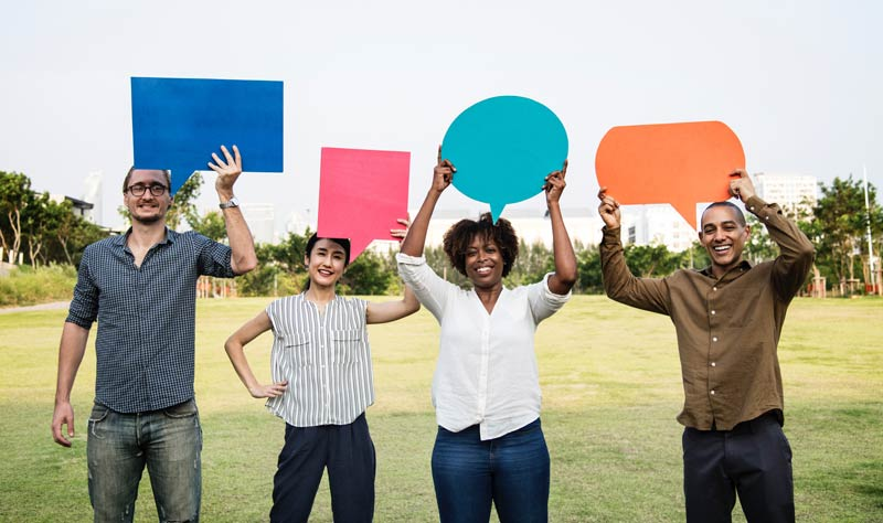 LGBTQ allies holding speech bubbles