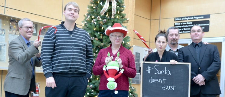 The Santa Claus Debate is set for Friday at 7 p.m. in the Canfor Theatre at UNBC. Organizers Gary Wilson and Todd Whitcombe are pictured with debaters Ben Bryce, Blanca Schorcht, Brenda Slomka and Greg Condon. Photo courtesy of UNBC
