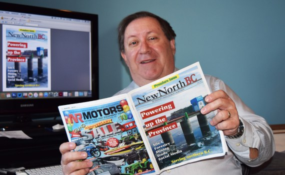 NewNorthBC publisher/editor Bill Phillips checks out the first issue of the magazine.