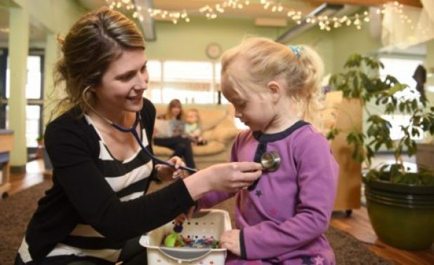 Nurse practitioner student Kristine Rowswell interacts with a child at the UNBC Childdcare Centre.
