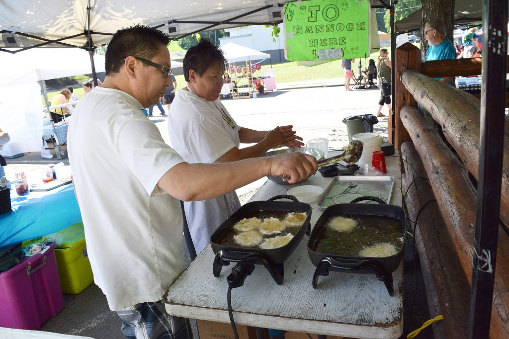 Cooking up the goodies at Jo's Bannock at the Farmer's Market Saturday. Bill Phillips photo
