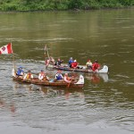 Voyageur canoes paddle the Fraser River near Lheidli T'enneh Memorial Park Thursday. The voyageurs left Fort St. James Monday and followed the old fur trader's route down the Stuart River to the Nechako River to the Fraser River. Bill Phillips photo