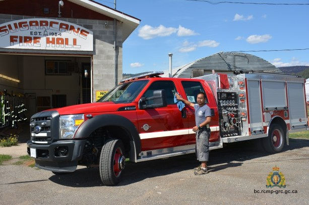 Ira Nelson cleans a Sugar Cane Band fire truck. RCMP photo