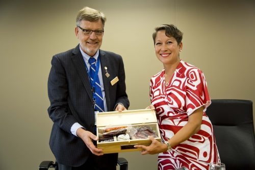 CNC President Henry Reiser presents Honourable Melanie Mark with a traditional First Nations gift. CNC photo