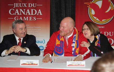 An emotional Anthony Everett, chair of the 2015 Canada Winter Games, is consoled by Prince George-Valemount MLA Shirley Bond and Canada Games Council chair Tom Quinn during the closing press conference for the Games.