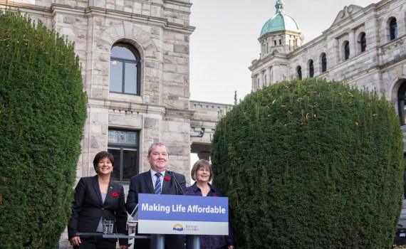 Minister Shane Simpson announces the chairs of the province's forum on poverty reduction, Mabel Elmore (left), and Prince George's Dawn Hemingway. Province of BC photo