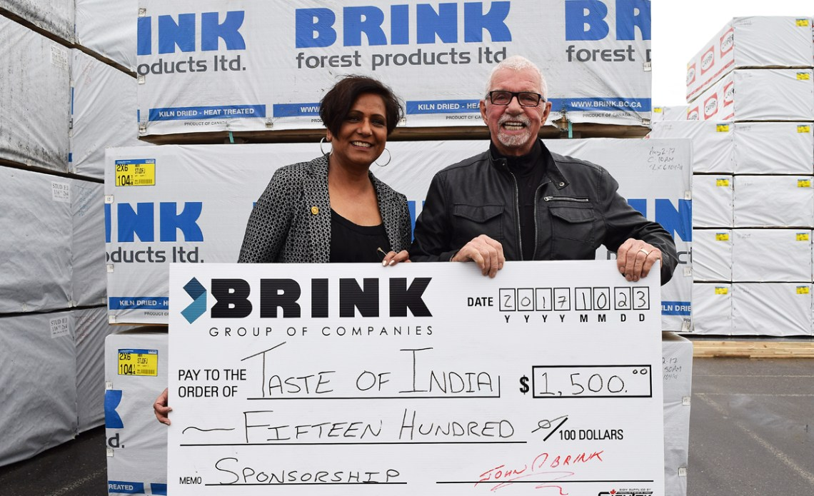 John Brink, of the Brink Group of Companies, presents Kim Gill of the Taste of India with a cheque for $1,500. The annual Taste of India event is slated for February 24, 2018. Bill Phillips photo