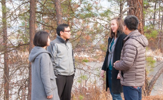 UBC researchers (from left to right) Abby Yang, Associate Professor Adam Wei, Krysta Giles-Hansen and Qiang Li discuss the role forest vegetation plays while monitoring water resources. UBC photo