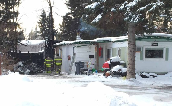 Prince George Fire Rescue attend a shed fire on Opal Drive in the Hart Thursday. Crews from three halls attended and kept the fire from spreading. The cause is under investigation. Bill Phillips photo