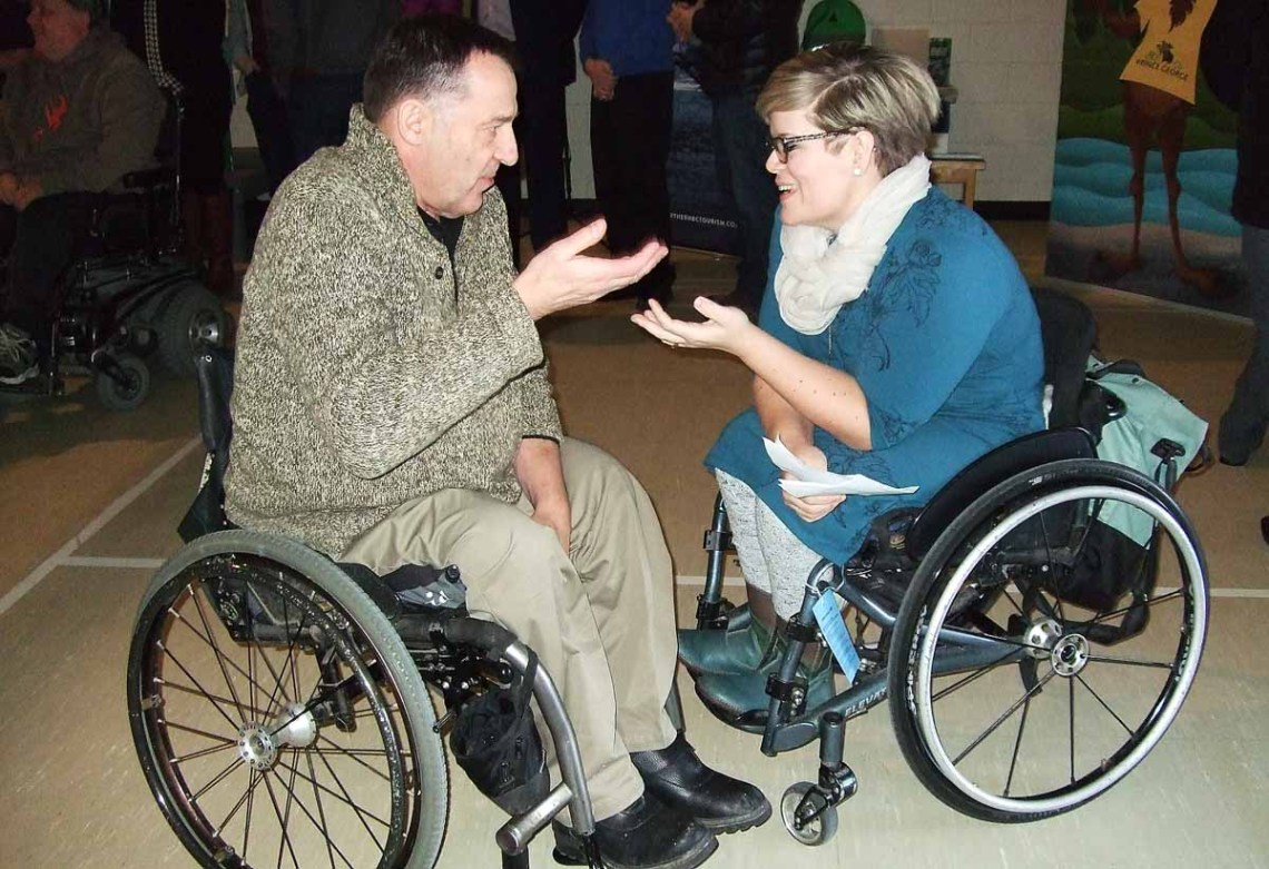 Prince George's Pat Harris chats with Jocelyn Maffin, BC SCI Resource Centre Manager, Spinal Cord Injury BC during Access North Day Friday. Bill Phillips photo