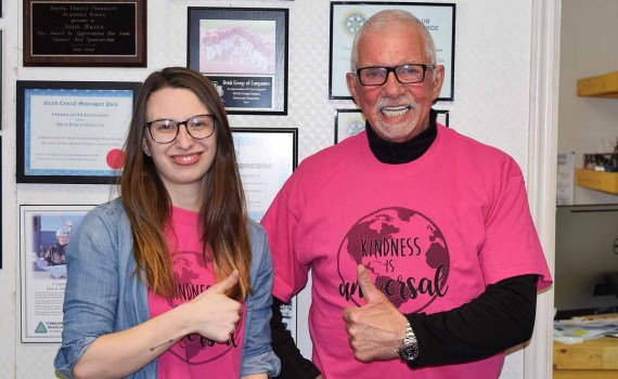 Darby Brand of Big Brothers and Big Sisters of Prince George and John Brink of the Brink Group of Companies remind everyone to wear pink on Wednesday in support of efforts to stop bullying. Bill Phillips photo