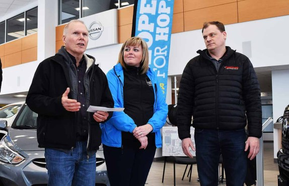 Doug Jones; Amiee Cassie, Prince George Relay for Life coordinator, and Kyle Bachman, dealer principal of Northland Nissan announce that Northland and AutoCanada will give registered Relay for Life participants an opportunity to win a new car. Bill Phillips photo