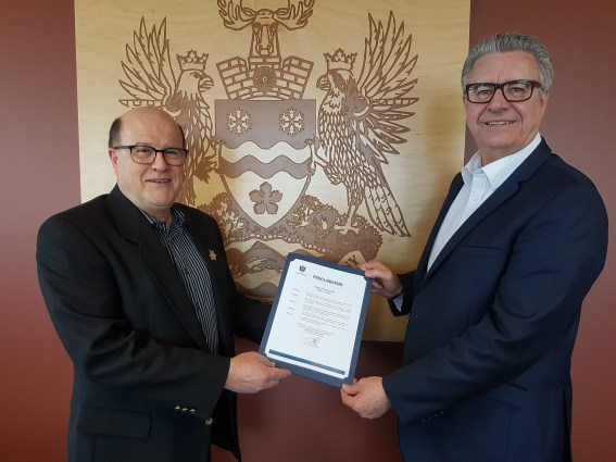 Climb for Cancer Committee Chair David Duck accepts the official proclamation from Mayor Lyn Hall. Photo submitted
