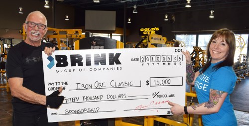 John Brink presents Karley Green with a $15,000 cheque as the Brink Group of Companies is the title sponsor for the Iron Ore Classic.
