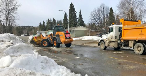City crews remove windrows to prepare for spring street sweeping. Delaying windrow removal would push sweeping operations later into the year and affect air quality. City of Prince George photo