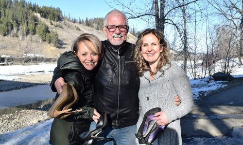 Erin Simpson (left) and Sarah Bonnar of the Healin' for Cancer team with John Brink of the Brink Group of Companies are ready to climb the iconic cutbanks behind them.