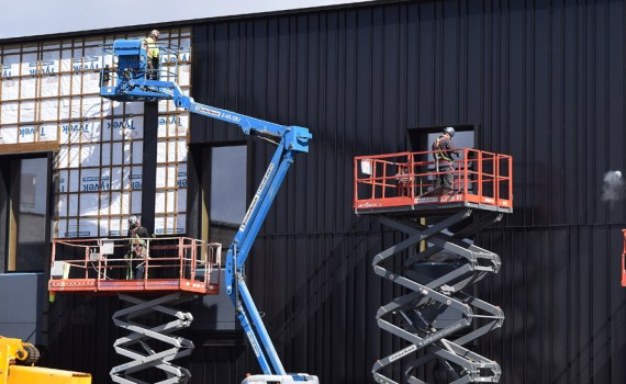 Crews work on finishing the siding for the UNBC's Wood Innovation Research Lab downtown. Bill Phillips photo
