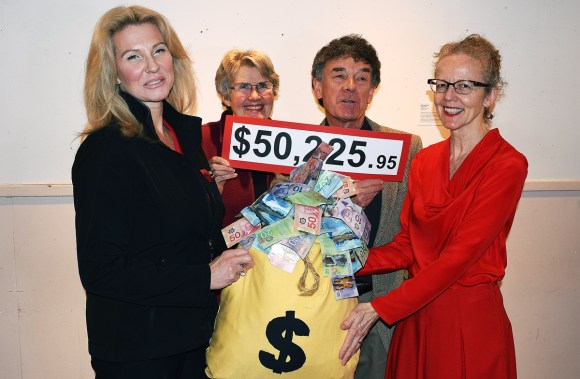 Roberta Squire (left), CEO of the United Way of Northern B.C. and board member Margaret Jones-Bricker accept $50,225 from Ted Price and Anne Laughlin of the Miracle Theatre. Bill Phillips photo