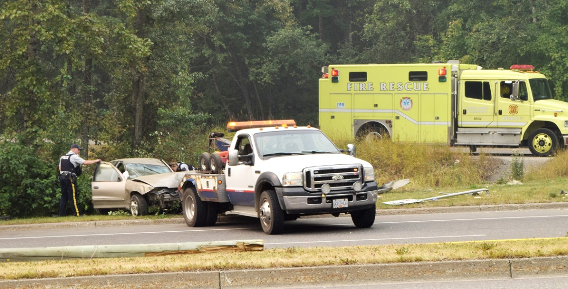 RCMP examine a vehicle that crashed at the foot of Cranbook Hill Road just of Foothills Drive Wednesday morning. More to come. Bill Phillips photo