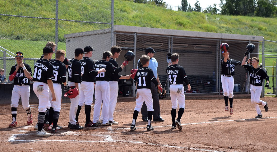 Prince George Knights player Brenden Gaboury (right) is greeted at the plate after hitting a three-run homer against the Burnaby Braves during the BC Minor Baseball 15U bantam AA championships earlier this week. The Knights downed the Cowichan Valley Mustangs 15-7 Tuesday to go a perfect 6-0 during the tournament and capture the provincial title. Bill Phillips photo