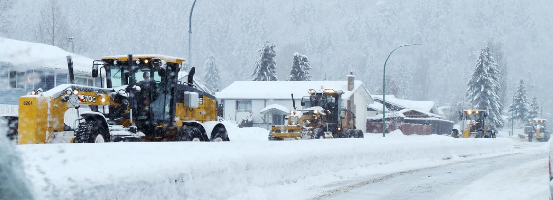 A line of graders work on clearing snow along Fifth Avenue Friday morning. If driving, or walking, today, be very careful on the roads. There is lots of snow and conditions aren't the best. Bill Phillips photo